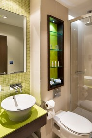 Now showing photo 7, The elegant design flows into the bathroom